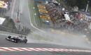 Michael Schumacher tackles Eau Rouge in the wet