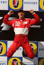 Michael Schumacher celebrates on the podium