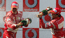Ferrari's Michael Schumacher and Felipe Massa celebrate on the podium