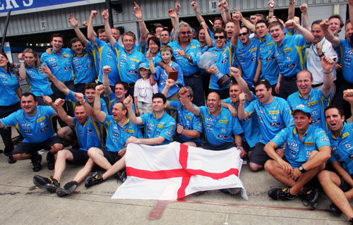The Renault team celebrate Fernando Alonso's victory at the 2006 British Grand Prix