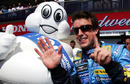 Fernando Alonso celebrates his sixth win of the season with the Michelin man