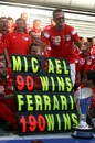 Michael Schumacher celebrates his win 90th win
