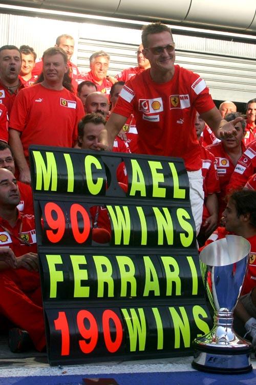 Michael Schumacher celebrates his win 90th win