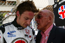 Sir Stirling Moss offers Jenson Button some advice