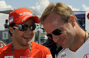 Felipe Massa and Rubens Barrichello share a joke at the Hungaroring