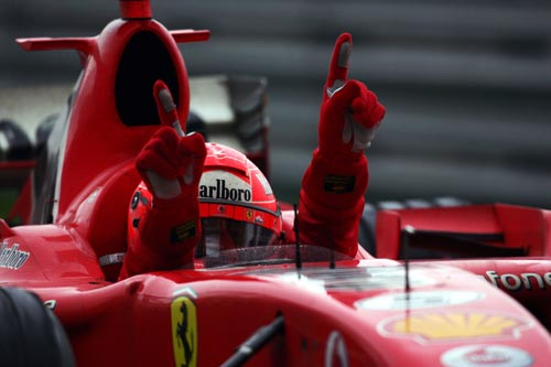 Ferrari driver Michael Schumacher celebrates his victory at the 2006 Chinese Grand Prix.