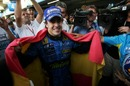 Fernando Alonso is all smiles after clinching the 2006 Formula One world title.