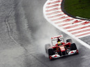 Felipe Massa splashes through the puddles during first practice