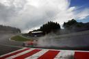 Felipe Massa splashes through Eau Rouge