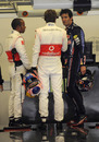 Mark Webber talks to Lewis Hamilton and Jenson Button after qualifying