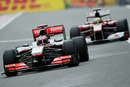 Jenson Button heads Felipe Massa