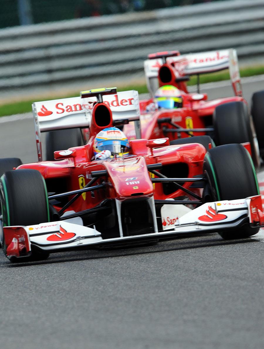 Fernando Alonso leads Felipe Massa