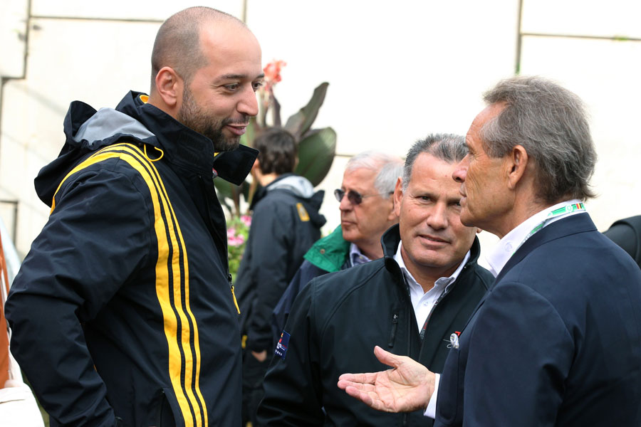 Renault team owner Gerard Lopez taks to Belgian racing legend Jacky Ickx on race day