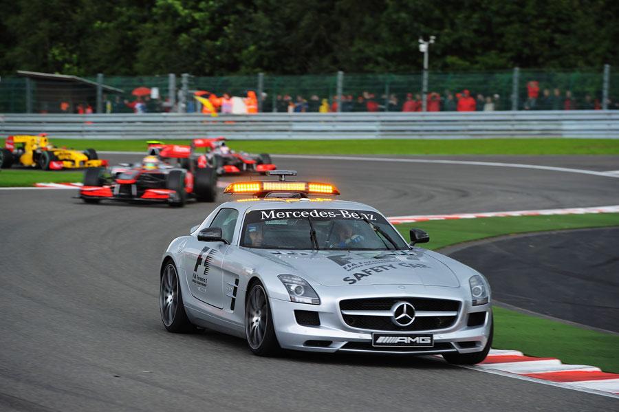 Lewis Hamilton follows the safety car