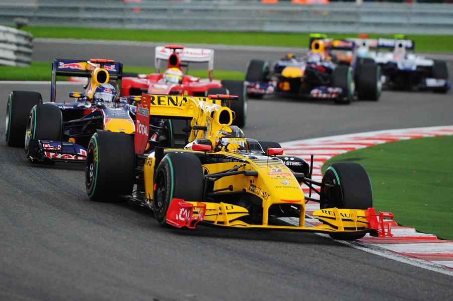 Robert Kubica leads Sebastian Vettel