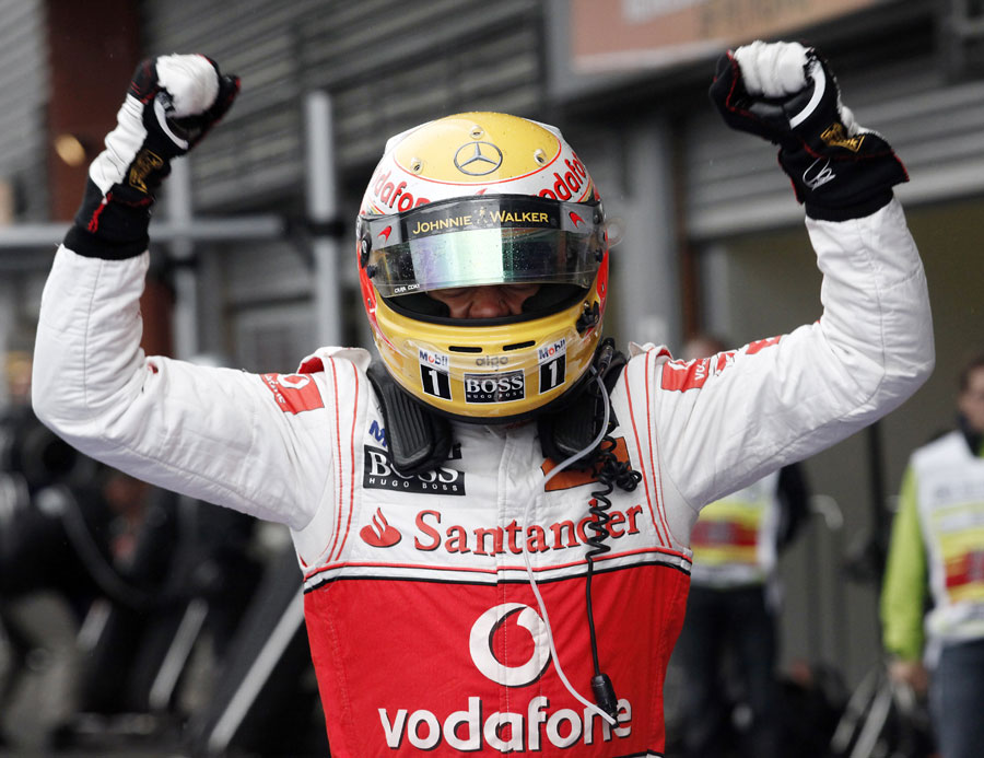 Lewis Hamilton celebrates winning the Belgian Grand Prix for the first time
