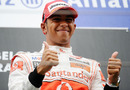 Lewis Hamilton shows his delight at winning his first Belgian Grand Prix