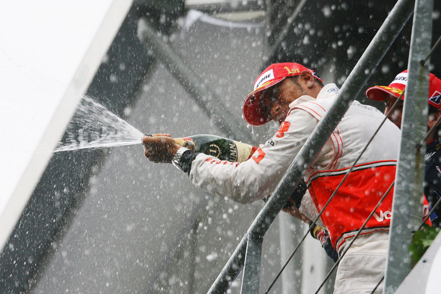 Lewis Hamilton sprays champagne after winning his first Belgian Grand Prix