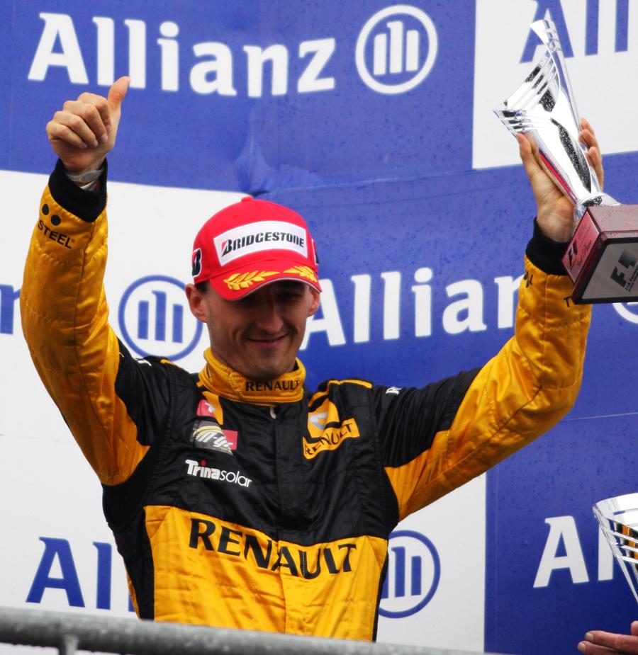 Robert Kubica celebrates his third-place finish