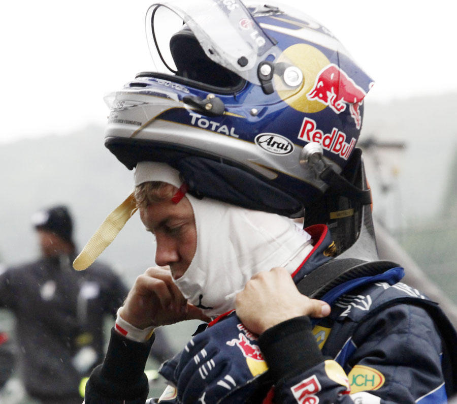 Sebastian Vettel takes off his helmet at the end of a forgettable afternoon for him