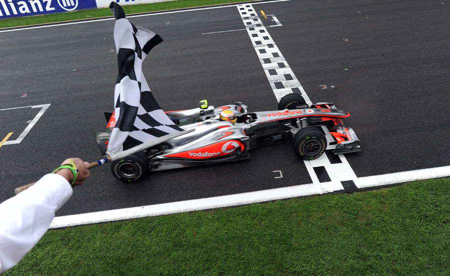 Lewis Hamilton takes the chequered flag for victory