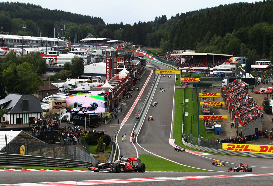 Lewis Hamilton leads the field through Eau Rouge at the start
