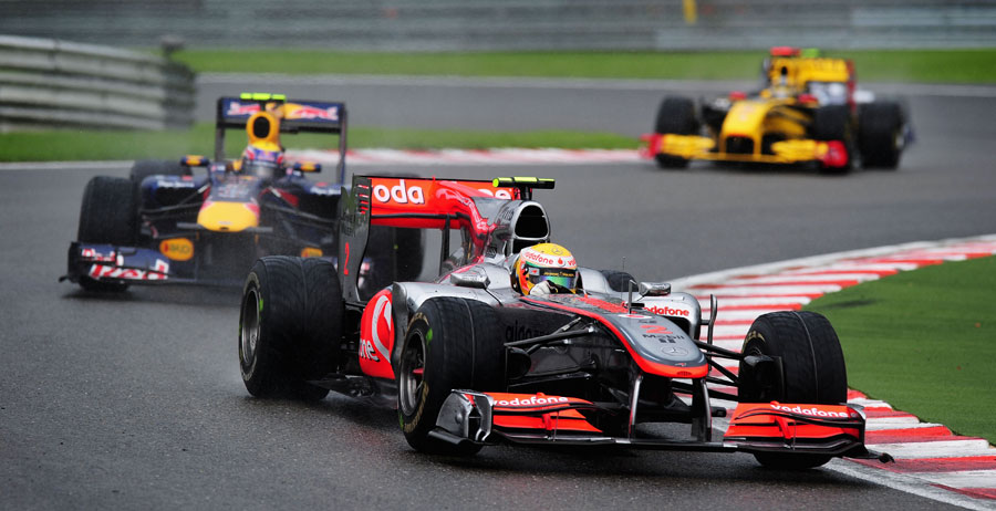 Lewis Hamilton holds off Mark Webber in the rain