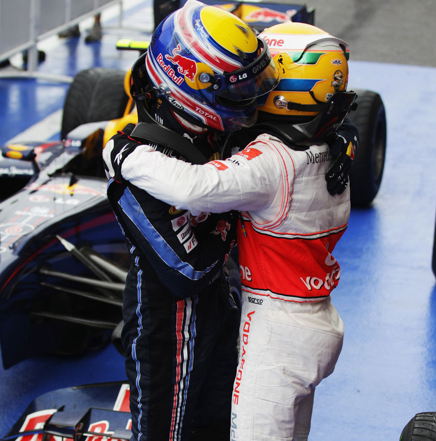 Lewis Hamilton receives a victory hug from Mark Webber