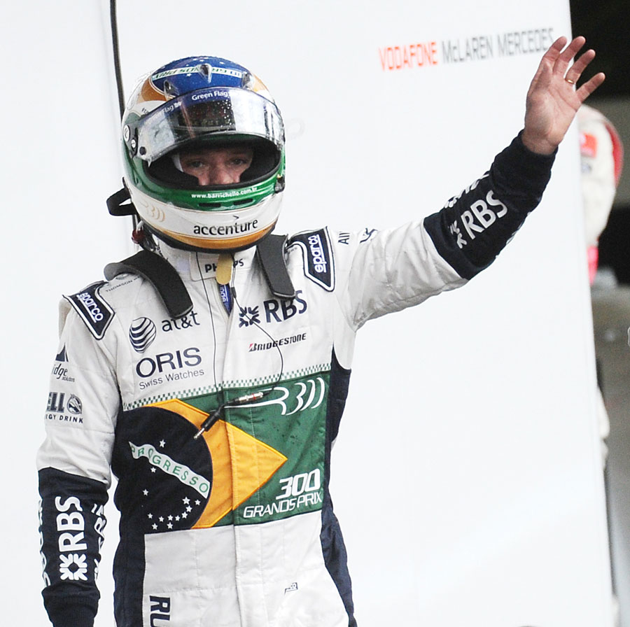 Rubens Barrichello waves to his fans after crashing out