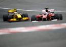Fernando Alonso leads Vitaly Petrov