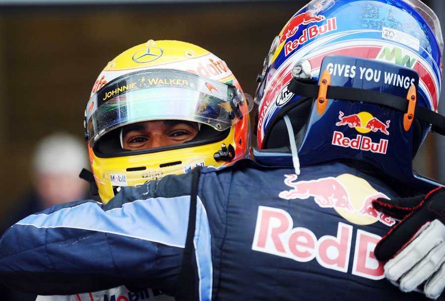 Lewis Hamilton is congratulated by Mark Webber