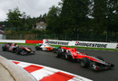 Timo Glock leads Sebastien Buemi and tonio Liuzzi through La Source