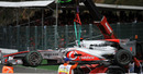 Jenson Button's wrecked McLaren is cleared away