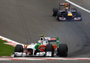 Tonio Liuzzi leads Sebastian Vettel through Eau Rouge