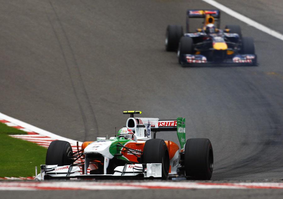Tonio Liuzzi leads Sebastian Vettel through Eau Rouge