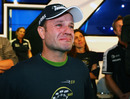 An emotional Rubens Barrichello watches a tribute to his career at his 300th grand prix