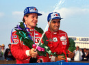 Rubens Barrichello celebrates victory alongside Jordi Gene