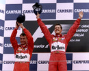 Michael Schumacher celebrates a Ferrari 1-2 with team-mate Eddie Irvine