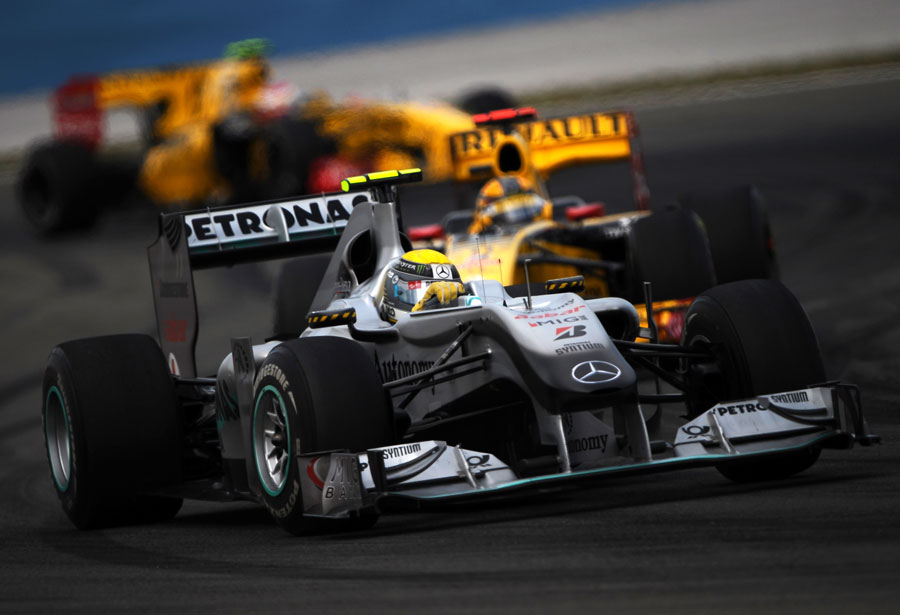 Robert Kubcia and Vitaly Petrov hunt down Nico Rosberg