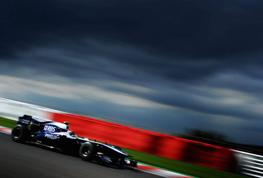 Nico Hulkenberg under a stormy sky at Spa