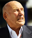 Sir Stirling Moss in the paddock