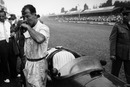 Stirling Moss stands by his car ahead of the race