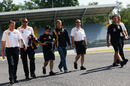 Vitaly Petrov walks the circuit with some Renault engineers