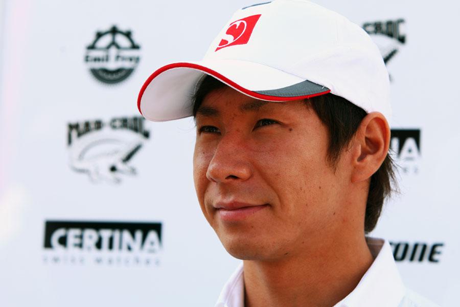 Kamui Kobayashi prepares for interviews in the paddock
