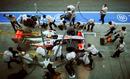 Lewis Hamilton practices a pit stop