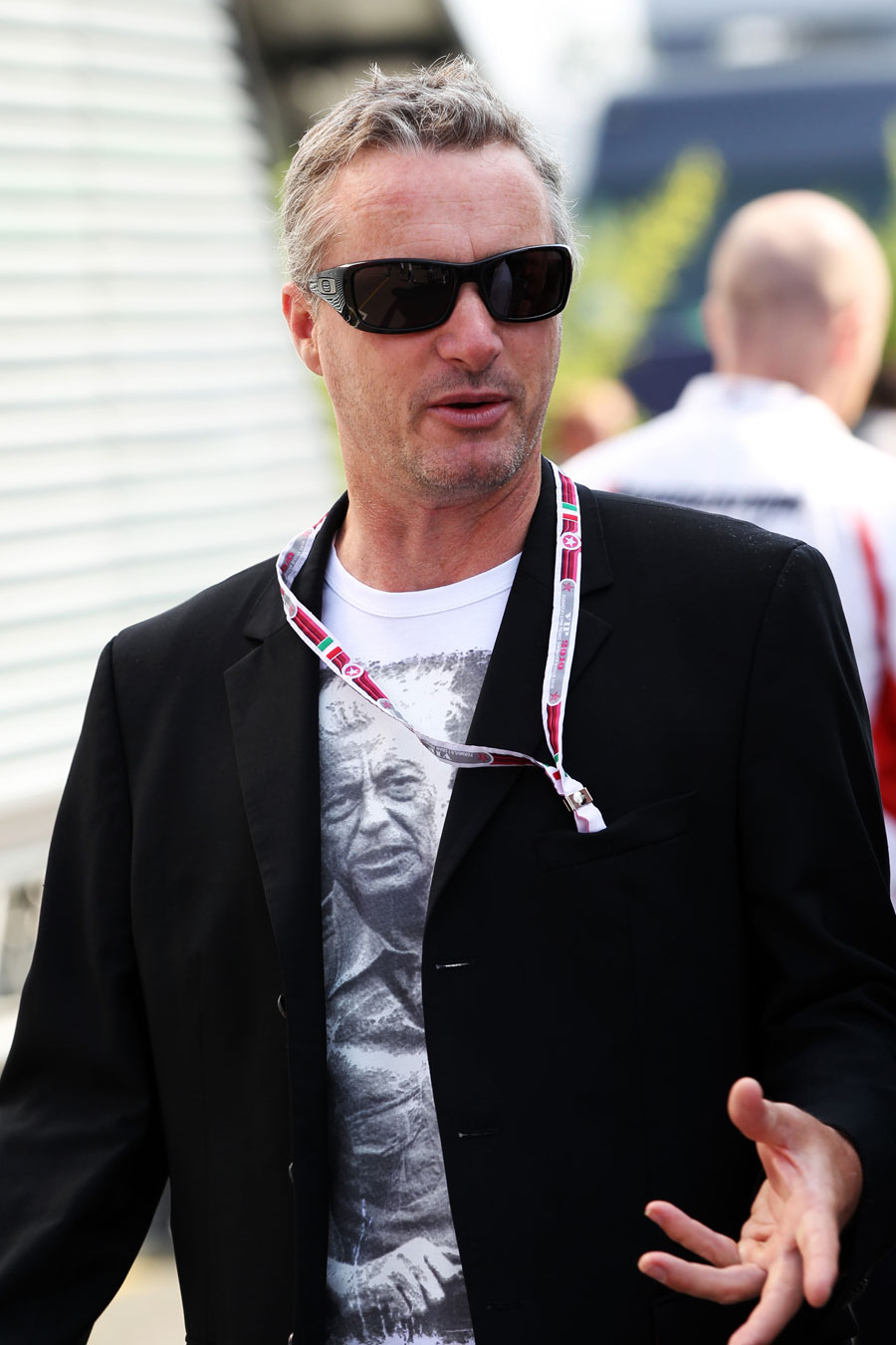 Former Ferrari driver Eddie Irvine soaks up the pre-race build-up