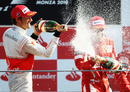 Jenson Button sprays Fernando Alonso with champagne