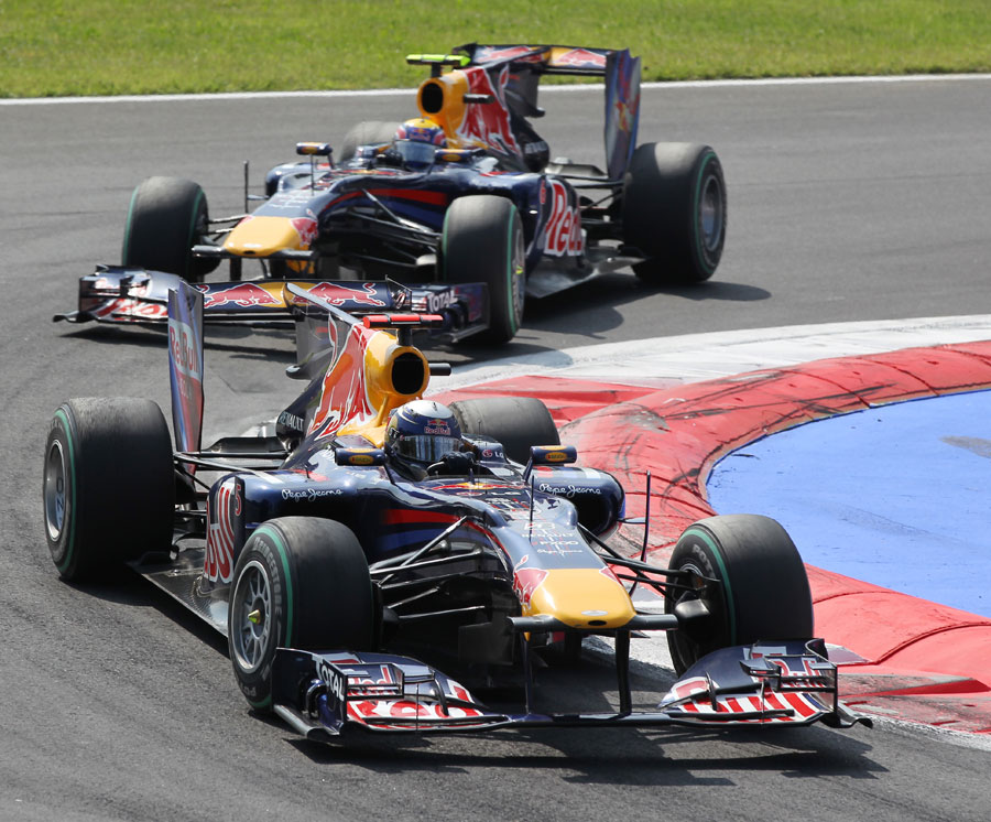 Sebastian Vettel leads Mark Webber through the first chicane