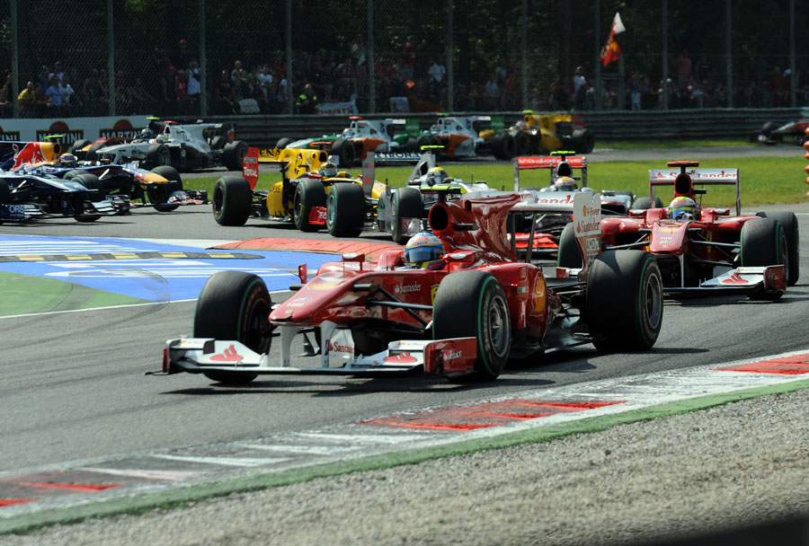 Fernando Alonso and Felipe Massa lead the field though the second chicane
