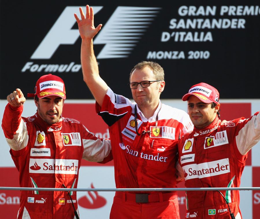 Stefano Domenicali celebrates Ferrari's Monza victory with Fernando Alonso and Felipe Massa on the podium